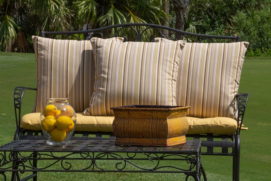 outdoor furniture with cushions on golf course
